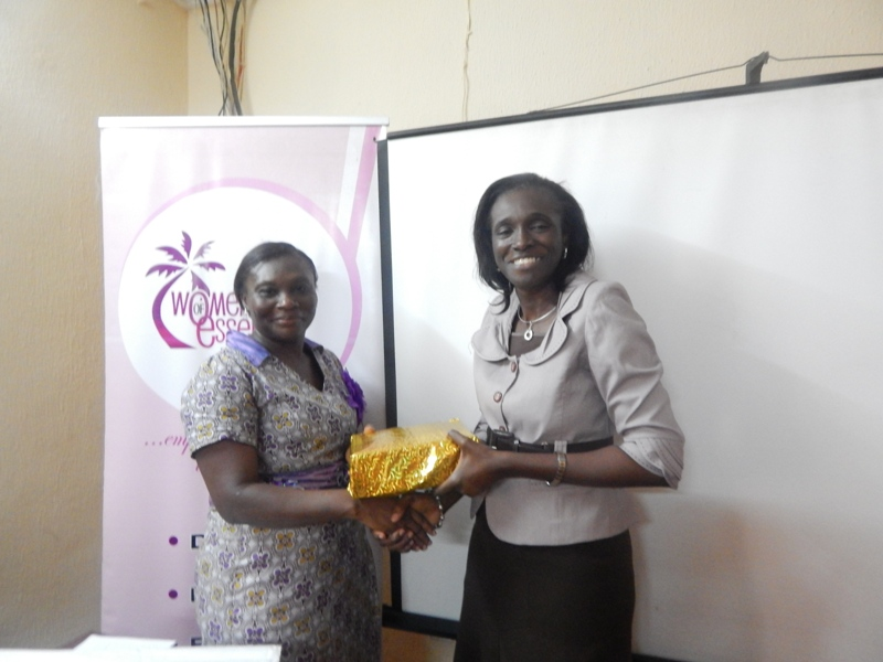 A participant being awarded for punctuality by the President and Founder of WOMEF