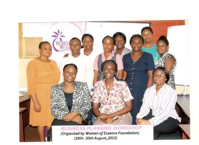 Participants with guest facilitator and WOMEF staff