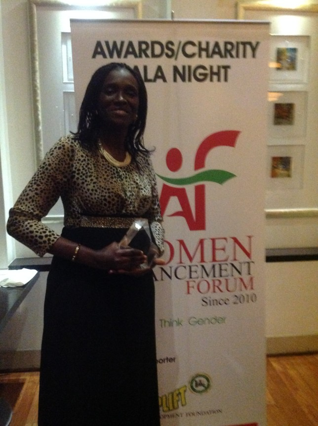 WOMEF Founder, Mrs Omokorede Holding her award.